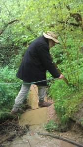 George Solt crossing rope bridge